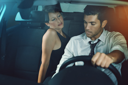 Sensual woman seducing her chauffeur. Passion and seduction concept